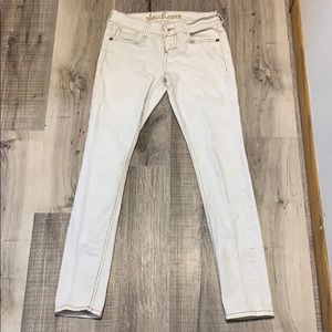 White skinny jeans with light gold snakeskin color